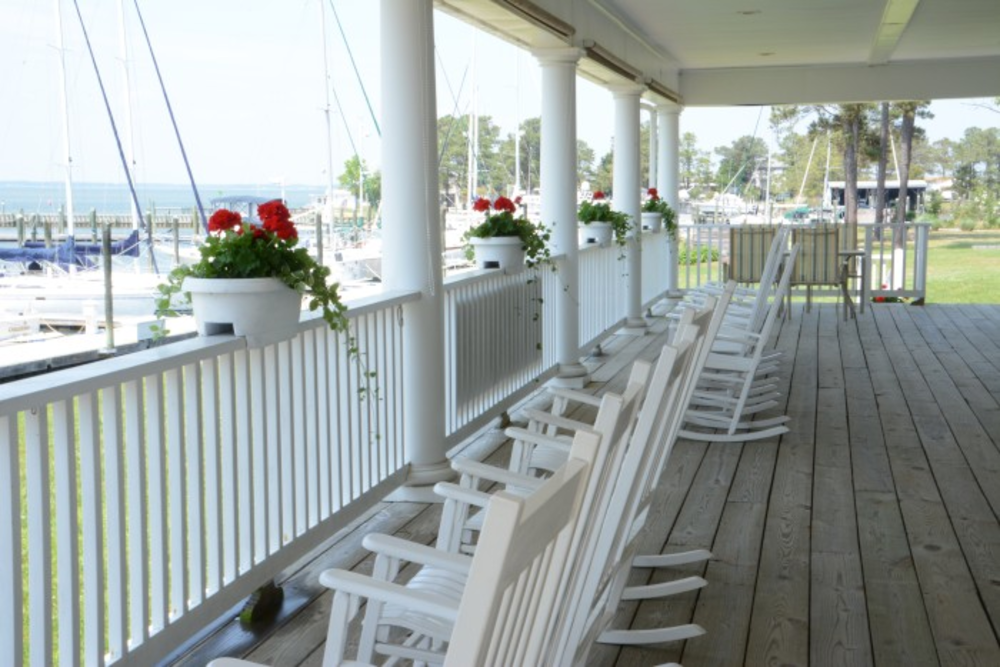 Dozier's Regatta Point Yachting Center porch with rocking chairs overlooking the ocean